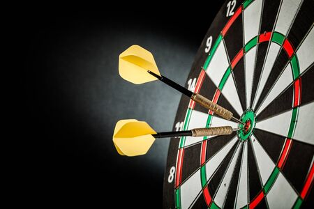 Photo pour Closeup of Darts in Bullseye - image libre de droit