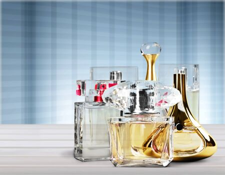 Photo for Aromatic Perfume bottles on wooden table on blurred background - Royalty Free Image