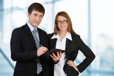 Group of confident businesspeople on light background