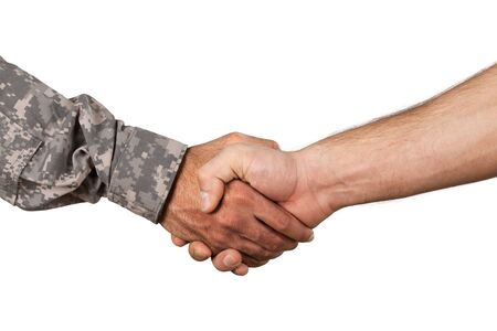 Photo for Soldier and Man Shaking Hands - Royalty Free Image