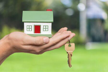 Photo pour Businessman Holding House Model and Keys - image libre de droit