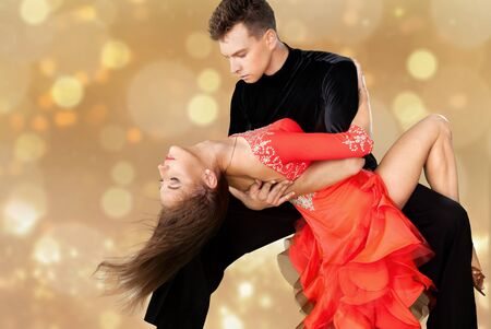 Foto de Man and a woman dancing Salsa on background - Imagen libre de derechos