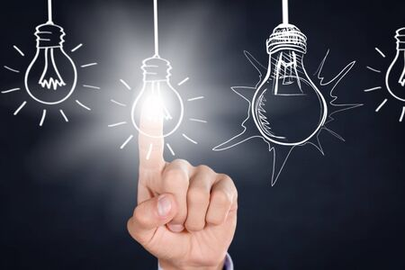 Photo for Businessman touching light bulbs - Royalty Free Image