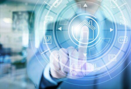 Foto de Circular futuristic interface of smart home automation assistant on a virtual screen and a user touching a button - Imagen libre de derechos
