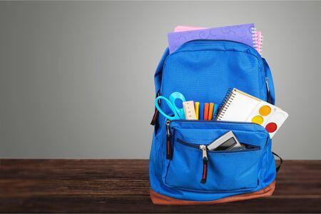 Photo pour Open blue school backpack on wooden desk - image libre de droit