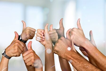 Photo pour Group of people hands showing thumbs up signs on background - image libre de droit