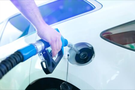 Photo for Pumping gas at gas pump. Closeup of man pumping gasoline fuel in car at gas station. - Royalty Free Image