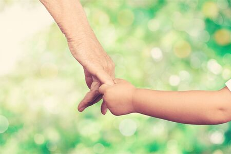 Photo for Close up photo of father holding baby hand - Royalty Free Image