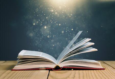 Photo pour Open book on old wooden table - image libre de droit