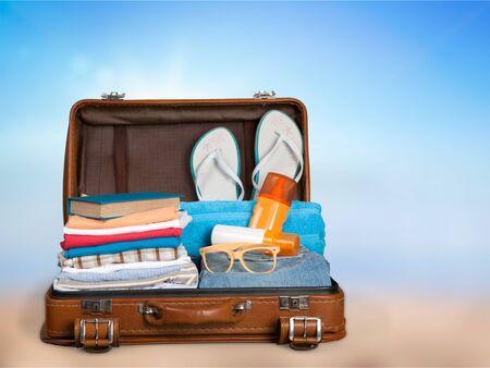 Photo pour Retro suitcase with travel objects  on hotel background - image libre de droit