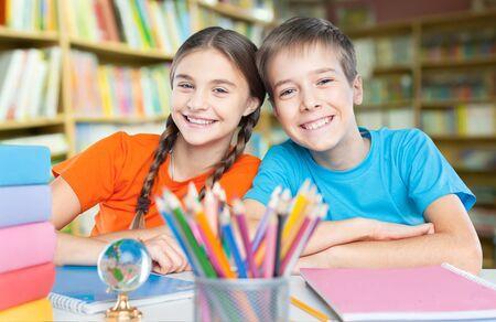 Photo pour Child in classroom - image libre de droit