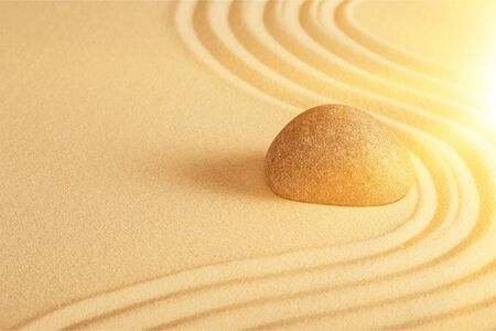 Photo for Zen stone in the sand on Background - Royalty Free Image