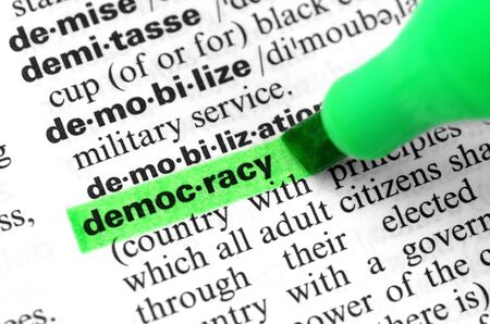 Photo for Close Up of Highlighting Specific Word Democracy in a Dictionary - Royalty Free Image
