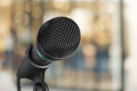Photo pour Public hearing with microphone voice speaker in business seminar, speech presentation - image libre de droit