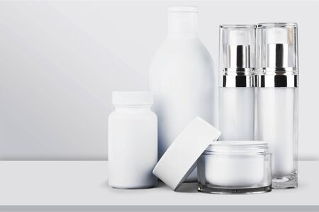Photo pour Cosmetic containers isolated on background - image libre de droit