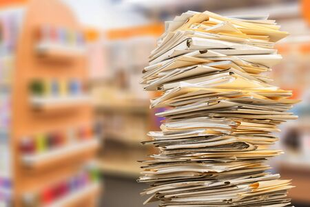 Stack of business documents on background