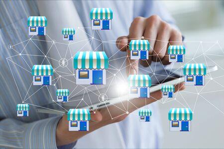 Photo pour Businessman showing Franchise system on a mobile device. - image libre de droit