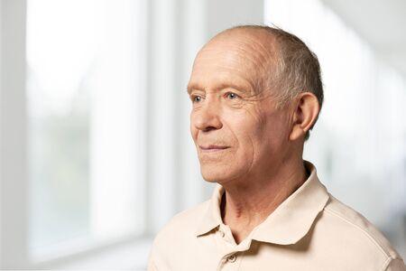 Photo pour Senior man in blue shirt and glasses - image libre de droit