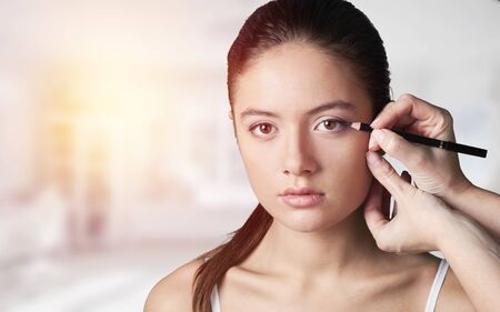 Photo pour Black eyeliner. Unbelievably beautiful young dark-haired woman - image libre de droit