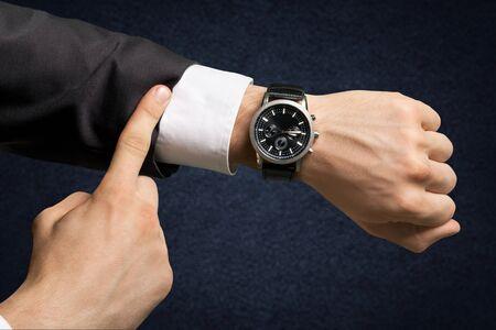 Photo pour Businessman pointing at hand watch on white - image libre de droit