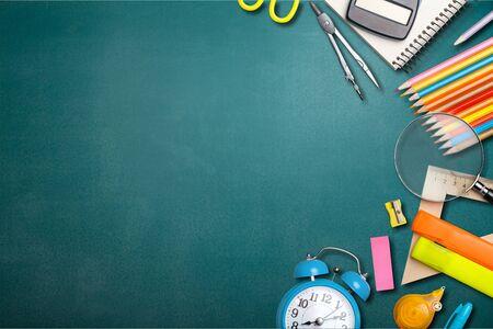 Photo pour School supplies on black board background. Back to school concept - image libre de droit
