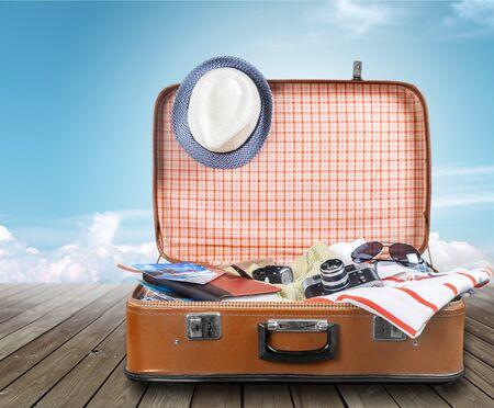 Photo pour Suitcase with clothes and other travel accessories - image libre de droit