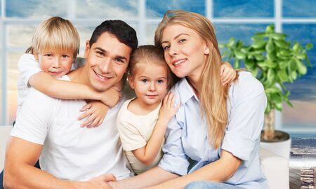 Photo for Beautiful smiling family sitting at sofa on - Royalty Free Image