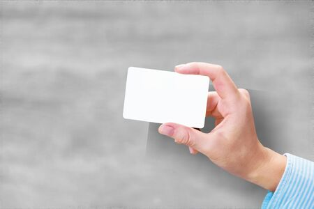 Foto de Hand hold blank translucent card mockup with rounded corners. Plain clear call-card mock up template holding arm. Plastic transparent acrylic namecard display front. - Imagen libre de derechos