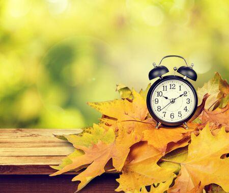 Photo pour Retro alarm clock on table  background - image libre de droit