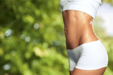 Photo for Close-up beautiful slim female body at blurred solar park - Royalty Free Image