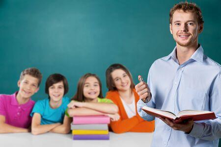 Foto de Young male teacher and school child - Imagen libre de derechos
