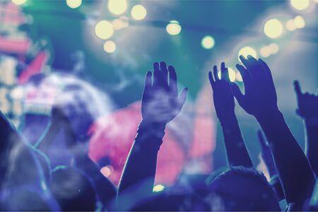 Photo pour Audience with hands raised at a music - image libre de droit