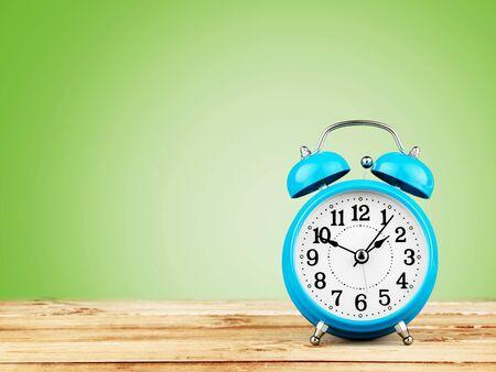 Foto de Blue Retro alarm clock on wooden table - Imagen libre de derechos