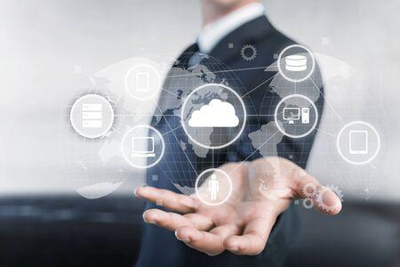 Foto de Businessman and internet and virtual reality concept - businessman pressing button on virtual screens - Imagen libre de derechos