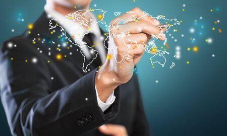 Photo pour Close up of businessman holding digital globe in palms - image libre de droit