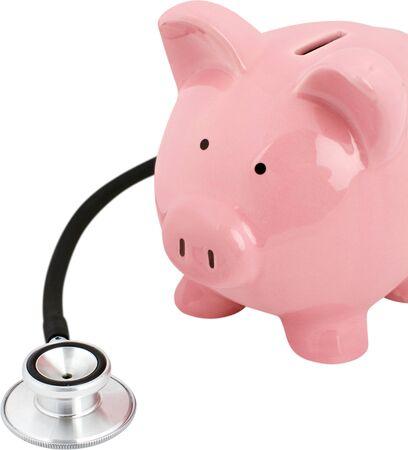 Photo pour Piggy bank with a stethoscope - financial check up concept - image libre de droit