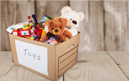 Photo pour Toys collection in box  isolated on  background - image libre de droit