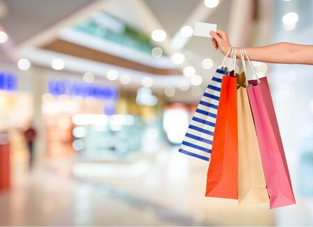 Photo pour Close up woman hand with many shopping bags and credit card - image libre de droit