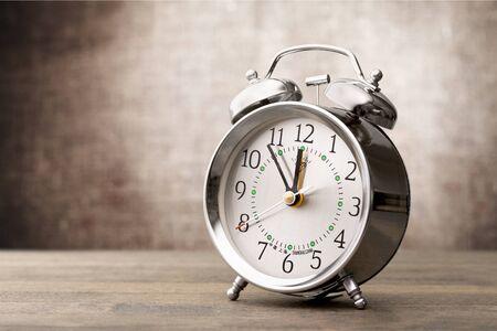 Foto de Vintage   retro alarm clock on table - Imagen libre de derechos