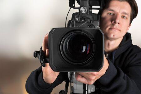 Photo pour Cameraman with his camera on blurred - image libre de droit