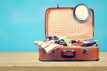 Photo pour Retro suitcase with travel objects on light - image libre de droit