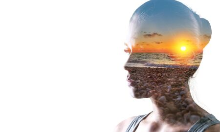 Psychoanalysis and meditation, concept. Profile of a young woman and sunset over the ocean, calm and mental health. Image with double exposure effect. The subconscious and how the brain works.          - Image