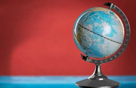 Photo pour Blue globe on table - image libre de droit