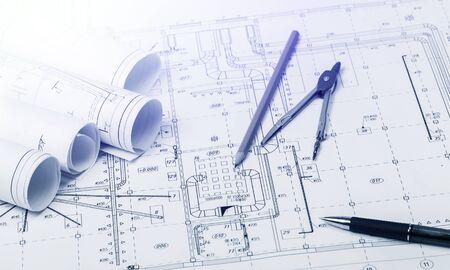 Foto de The part of architectural project and pencil, pen with divider on table - Imagen libre de derechos