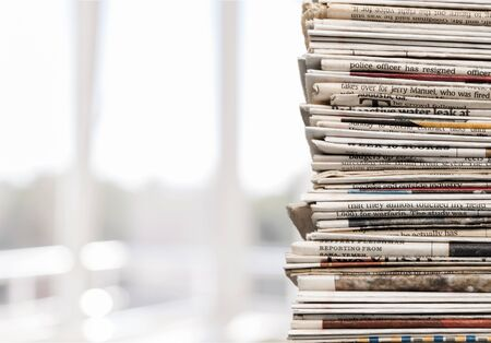 Photo pour Pile of newspapers on white background - image libre de droit
