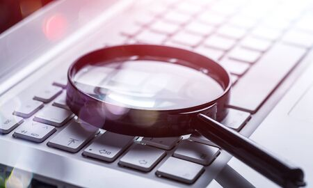 Photo for Magnifying glass on laptop keyboard close-up - Royalty Free Image