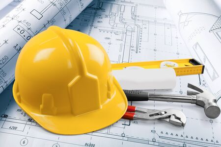 Photo pour isolated hard hat with tools and blueprint on white - image libre de droit