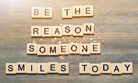 Foto de Be the reason someone smiles today quote - Imagen libre de derechos
