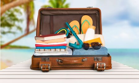 Photo for Retro suitcase with travel objects  on sea background - Royalty Free Image