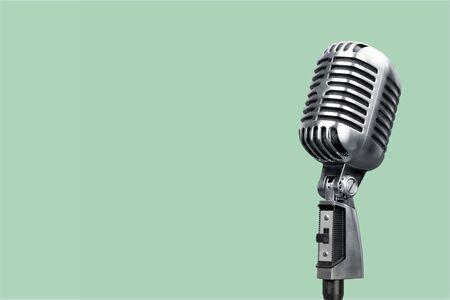 Photo pour Retro style microphone on background - image libre de droit